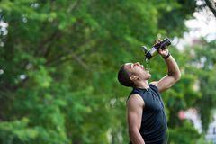 African american sportsman drinking water Stock Photo