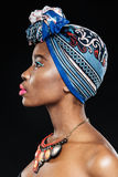 Side view of young african woman on black background Stock Images