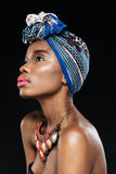 Side view of young african woman on black background Royalty Free Stock Image