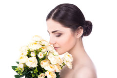 Side view of young beautiful woman with flowers isolated on whit Stock Photo