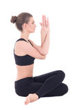 Side view of young beautiful woman sitting in yoga pose isolated Stock Photography