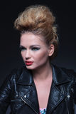 Side view of a young beauty woman in leather jacket Royalty Free Stock Photo