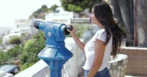 Woman exploring city with spyglass stock video footage