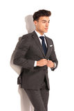 Side view of a young business man buttoning his suit Royalty Free Stock Photography