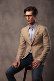 Side view of a young business man sitting Royalty Free Stock Photos