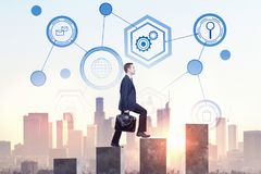 Success and career concept. Side view of young businessman climbing business chart ladder on abstract city background with business interface. Success and career Stock Photo