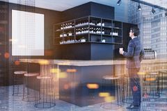 Businessman with a coffee in a bar. Side view of a young businessman holding a cup of coffee and looking at a mock up poster on a bar wall. 3d rendering mock up Royalty Free Stock Image