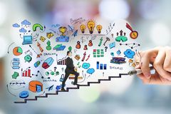 Career development and promotion concept. Side view of young businessman walking on drawn business sketch ladder on blurry bokeh background. Career development stock image