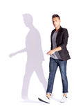 Side view of a young casual fashion man  walking Stock Images