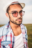 Side view of a young casual man looking away Stock Image