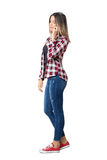 Side view of young casual woman talking on the mobile phone looking down. Stock Photos
