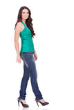 Side view of a young casual woman walking Royalty Free Stock Images