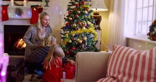 Family at home at Christmas time stock video footage