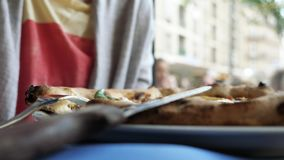 Side view of woman eating pizza in Italian authentic restaurant. Side view of young Caucasian woman tasting delicious pizza in authentic Italian restaurant with stock footage