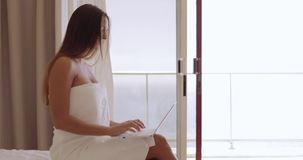 Girl relaxing with laptop in hotel stock footage