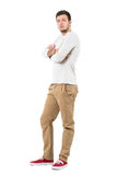 Side view of young confident stylish man with crossed arms. Royalty Free Stock Image