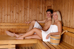Young couple enjoying sauna Stock Images