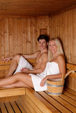 Young couple enjoying sauna Royalty Free Stock Image