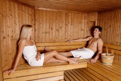 Young couple enjoying sauna Stock Photography