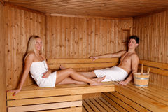 Young couple enjoying sauna Royalty Free Stock Photography