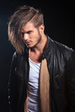 Side view of a young fashion man in leather clothes Royalty Free Stock Photo