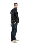 Side view of young fashion model in black leather jacket Stock Photos
