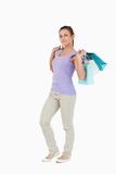Side view of young female with shopping bags Royalty Free Stock Images