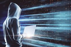 Big data and theft concept. Side view of young hacker using laptop on digital background. Big data and theft concept. Multiexposure stock photos
