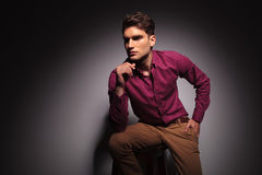 Side view of a young handsome man sitting Royalty Free Stock Image