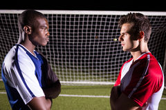Side view of young male soccer players looking at each other Royalty Free Stock Photos