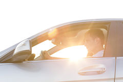 Side view of young man driving car Royalty Free Stock Photography