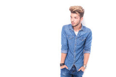 Side view of a young  man with hands in pockets Royalty Free Stock Image