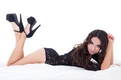 Side view of young sexy charming woman in black lace lingerie ly Royalty Free Stock Photos
