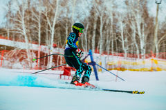 Side view young skier after finish of race downhill during Russian Cup in alpine skiing Royalty Free Stock Images