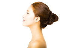 Side view young smiling  woman with clean face Stock Photos