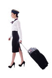 Side view of young stewardess walking with suitcase isolated on Stock Image