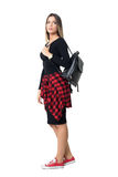 Side view of young stylish casual woman carrying bag looking away over the shoulder Royalty Free Stock Images