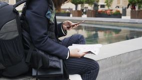 Side view of a young tourist girl with a smartphone and a map in Valencia stock video footage