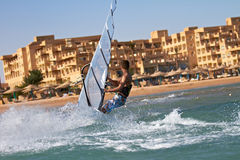 Side view of young windsurfer Royalty Free Stock Image