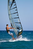 Side view of young windsurfer Stock Photo