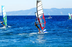 Side view of young windsurfer on background with other windsurfers royalty free stock image