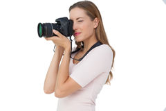 Side view of a young woman with camera Royalty Free Stock Image