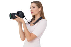 Side view of a young woman with camera Stock Photo