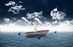 Side view of young woman carrying a pile of books in a sailboat Royalty Free Stock Image