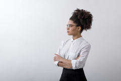 Side view of young woman indoors. Looking away Royalty Free Stock Photos