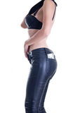 Side view of young woman in leather pants Royalty Free Stock Photo