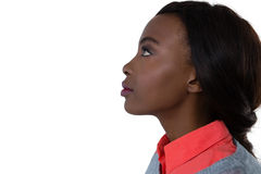 Side view of young woman looking up. Against white background Stock Image