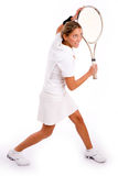 Side view of young woman playing tennis Stock Photography