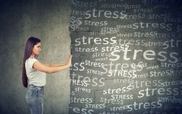 Side view of young woman pushing away block wall with stress. Willing to have happy life stock photos
