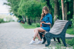 Side view of a young woman using  tablet computer Stock Photos